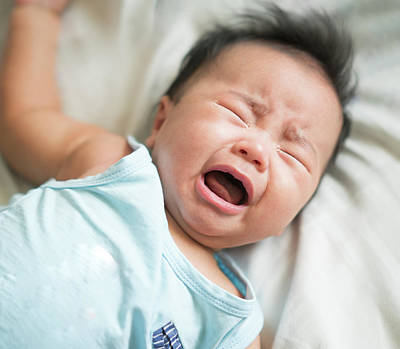 Photograph - Asian Baby Cry From Hungry  by Anek Suwannaphoom