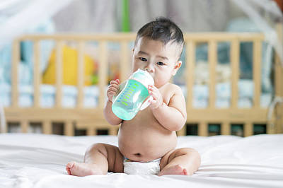 Photograph - Asian Baby Drink Water By Plastic Bottle by Anek Suwannaphoom