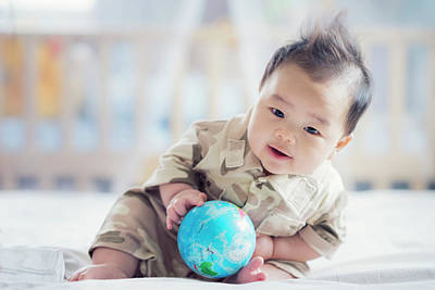 Photograph - Asian Baby In Soldier Uniform  by Anek Suwannaphoom