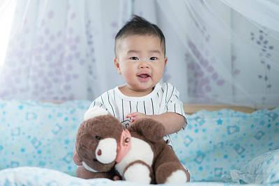 Photograph - Asian Baby Play A Teddy Bear by Anek Suwannaphoom