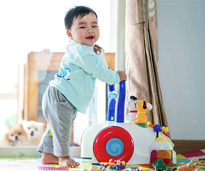 Photograph - Asian Baby Training Walking With Walker Toy by Anek Suwannaphoom