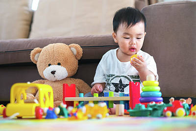 Photograph - Asian Boy Play A Toy With Teddy Bear In Lieving Room by Anek Suwannaphoom