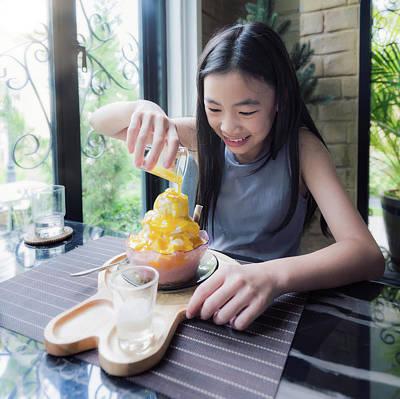 Photograph - Asian Girl Make Topping For  Mango Bingsu by Anek Suwannaphoom