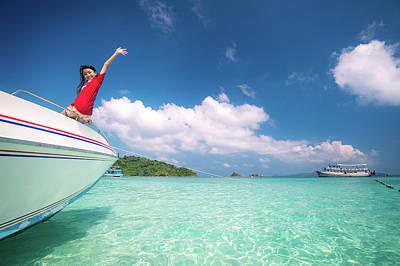 Photograph - Asian Girl On Speed Boat Between Sea Travel Trip by Anek Suwannaphoom