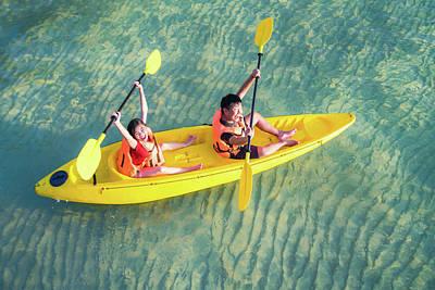 Photograph - Asian Kid To Play Kayak On The Beach by Anek Suwannaphoom
