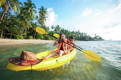 Photograph - Asian Kid To Play Kayak On The Beach On Koh Kood by Anek Suwannaphoom