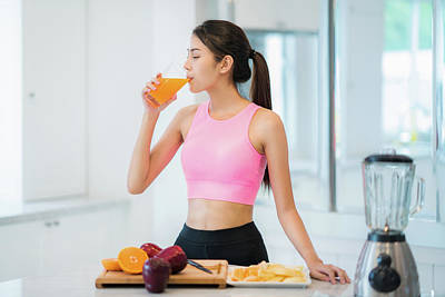 Asian Lady In Fitness Sport Wear Drink A Mix Fruit And Vegetable Art Print
