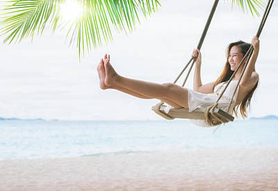 Photograph - Asian Lady Relax And Fun With Swing Under Coconut Leaves And San by Anek Suwannaphoom