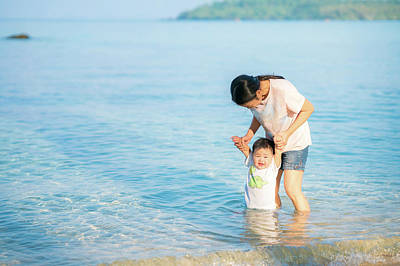 Photograph - Asian Mother And Baby Relax And Walking Togather On The Beach  by Anek Suwannaphoom
