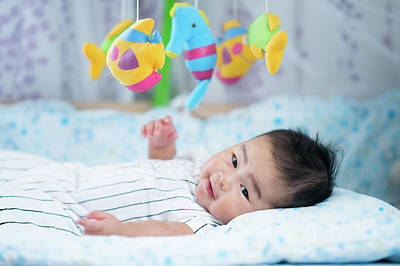 Photograph - Asian Newborn Baby Smile In A Bed by Anek Suwannaphoom