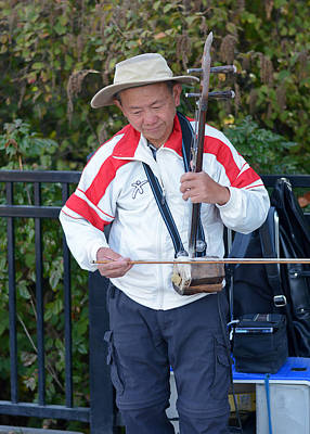 Photograph - Asian Street Musician Playing Erhu by Connie Fox