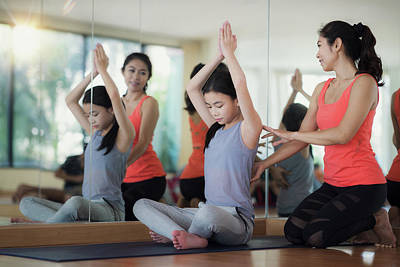 Photograph - Asian Woman Fitness Coach Teach Her Student by Anek Suwannaphoom