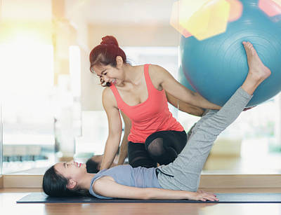Photograph - Asian Woman Fitness Coach Teach Her Student For Rubber Ball Exer by Anek Suwannaphoom