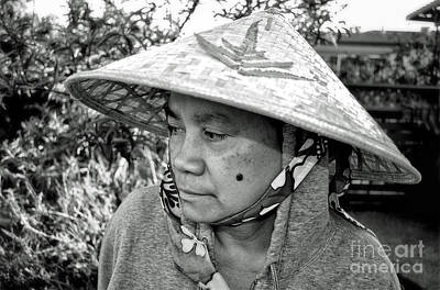 Filipino Photograph - Asian Woman With A Mole On Her Cheek And Wearing A Conical Hat  by Jim Fitzpatrick
