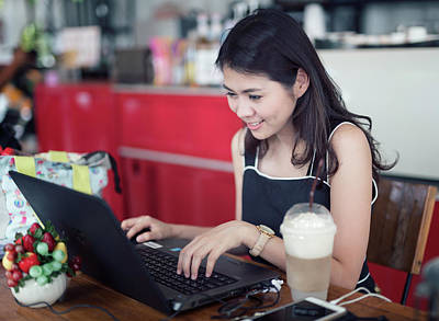 Asian Woman Working With Computer And Drinking Ice Coffee  Art Print