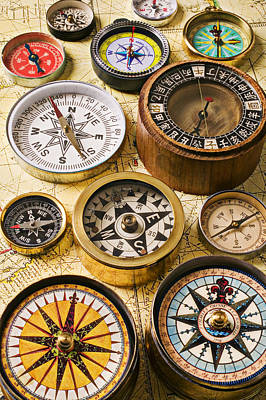 Guides Photograph - Assorted Compasses by Garry Gay