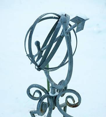 Photograph - Astrolabe Garden Ornament In The Snow by Douglas Barnett