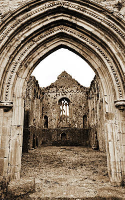 Photograph - Athassel Priory Tipperary Ireland Medieval Ruins Decorative Arched Doorway Into Great Hall Sepia by Shawn O'Brien