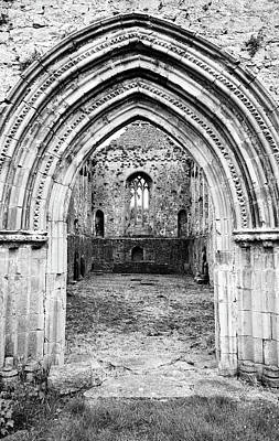 Photograph - Athassel Priory Tipperary Ireland Medieval Ruins Layered Arched Doorway Into Great Hall Bw by Shawn O'Brien
