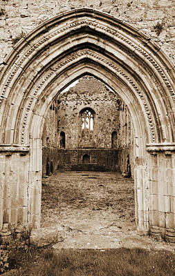 Photograph - Athassel Priory Tipperary Ireland Medieval Ruins Layered Arched Doorway Into Great Hall Sepia by Shawn O'Brien