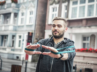 Photograph - Athlete Workout With Streching Tape by Michal Bednarek