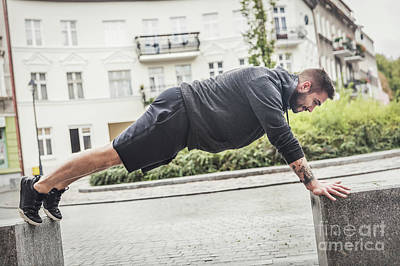 Photograph - Athletic Man Training On A Street. by Michal Bednarek