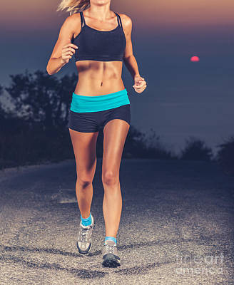 Photograph - Athletic Woman Jogging Outdoors by Anna Om