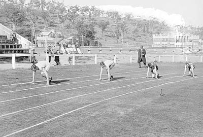 Athletes Royalty-Free and Rights-Managed Images - Athletics, North Hobart Oval. Shows Hobart High School in the background, Tasmania c1912 by Celestial Images