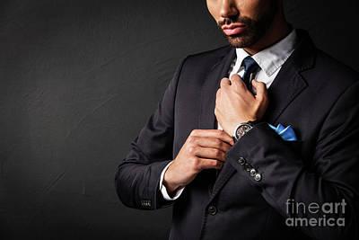 Photograph - Attractive Businessman Fixing His Tie. by Michal Bednarek
