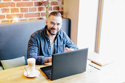 Photograph - Attractive Man Smiling In A Cafe. Working Environment. by Michal Bednarek