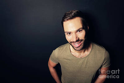 Photograph - Attractive, Smiling Man Standing Next To A Wall. by Michal Bednarek