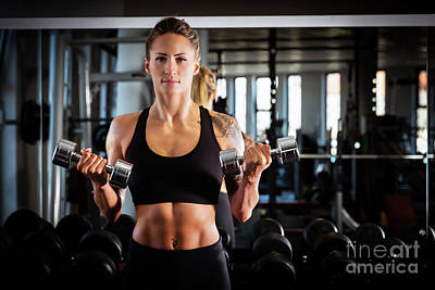 Photograph - Attractive Woman Exercising At The Gym. by Michal Bednarek