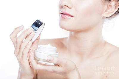 Photograph - Attractive Woman Opening A Face Cream. by Michal Bednarek