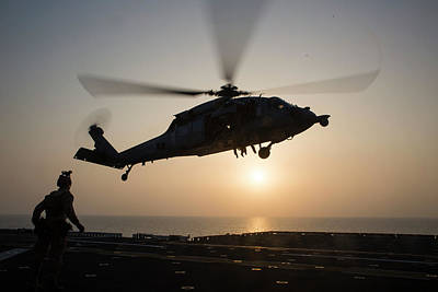 Photograph - Aus Navy Sh60 Sea Hawk Helicopter Hovers The Amphibious Assault Ship Uss Bataan Lhd 5 by Paul Fearn