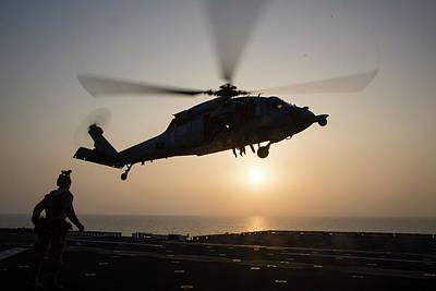 Photograph - Aus Navy Sh60 Sea Hawk Helicopter Hovers The Amphibious Assault Ship Uss Bataan Lhd 5 by Paul Fearn