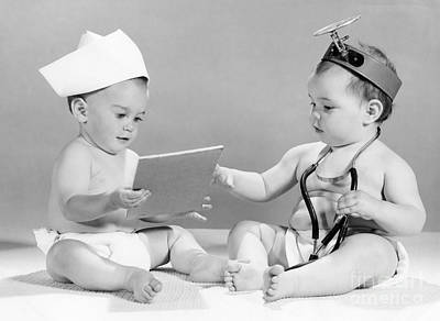 Photograph - Babies Playing Doctor, C.1960s by H Armstrong Roberts ClassicStock
