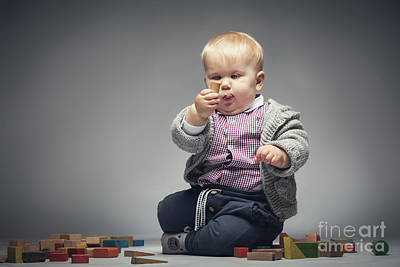 Photograph - Baby Boy Examining A Building Block. by Michal Bednarek