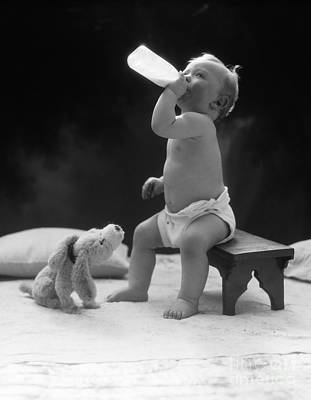 Baby Drinking Milk, 1930s Print by H. Armstrong Roberts/ClassicStock