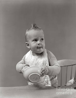 Highchair Photograph - Baby Eating Cereal With Hands, C.1940s by H. Armstrong Roberts/ClassicStock