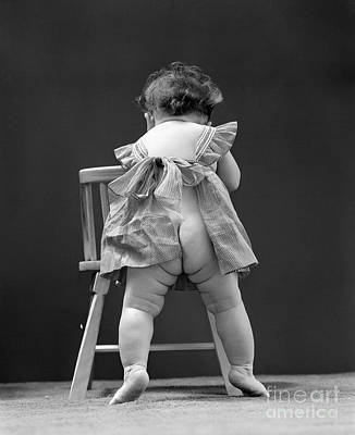 Naked Kids Photograph - Baby Girl In Pinafore, 1940s by H. Armstrong Roberts/ClassicStock
