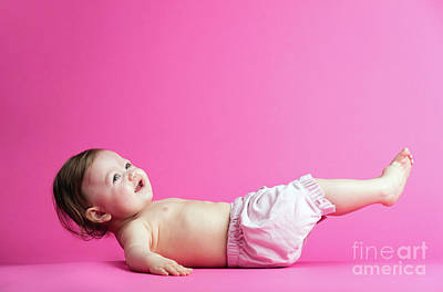 Photograph - Baby Girl Laying On Her Back, Trying To Get Up. by Michal Bednarek
