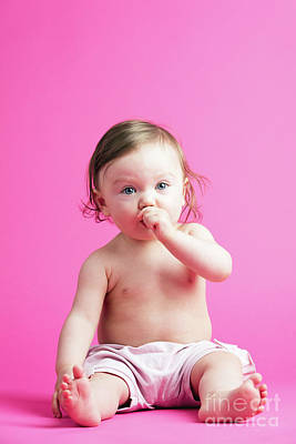 Photograph - Baby Girl Putting Her Hand Into Her Mouth. by Michal Bednarek