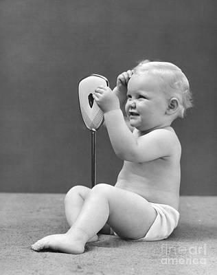Baby Girl With Hand Mirror, 1940s Art Print by H. Armstrong Roberts/ClassicStock