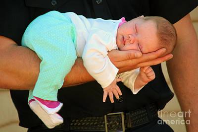 Photograph - Sleeping Baby In Hand by Wernher Krutein
