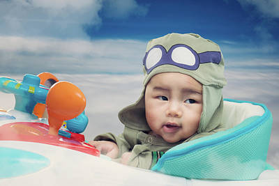 Photograph - Baby Play On Airplane Toy On The Sky by Anek Suwannaphoom
