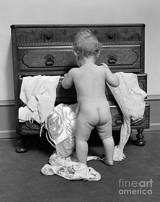 Naked Kids Photograph - Baby Pulling Clothes Out Of Chest by H. Armstrong Roberts/ClassicStock