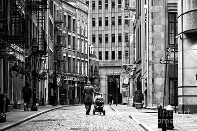 Baby Carriages Photograph - Baby Steps In New York City by John Rizzuto