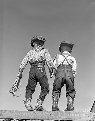 Best Friend Photograph - Back View Of Boys In Cowboy Costumes by D. Corson/ClassicStock