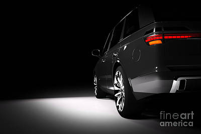 Photograph - Back View Of Modern Black Suv Car In A Spotlight by Michal Bednarek