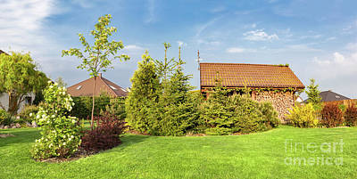 Photograph - Backyard Of A Family House. Landscaped Garden With Green Mown Grass, Wood Shelter. by Michal Bednarek